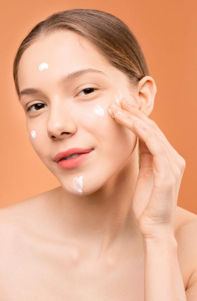 Canva-Woman-Applying-Facial-Cream-on-Her-Face